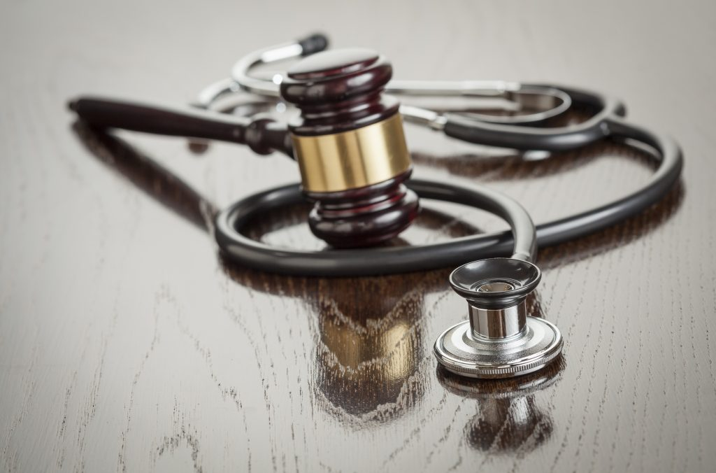 Photo of stethoscope and gavel.